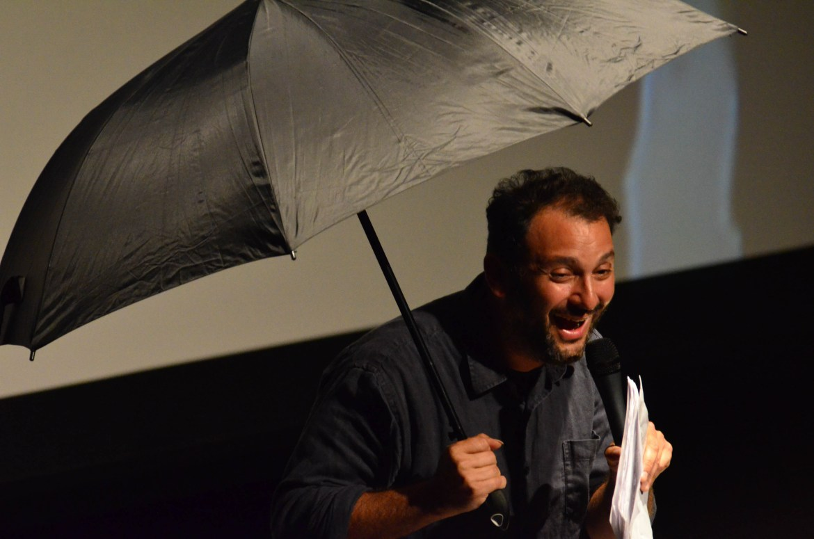 Filmmaker Josh Fox performs to a large crowd at Bailey Hall on Friday night.