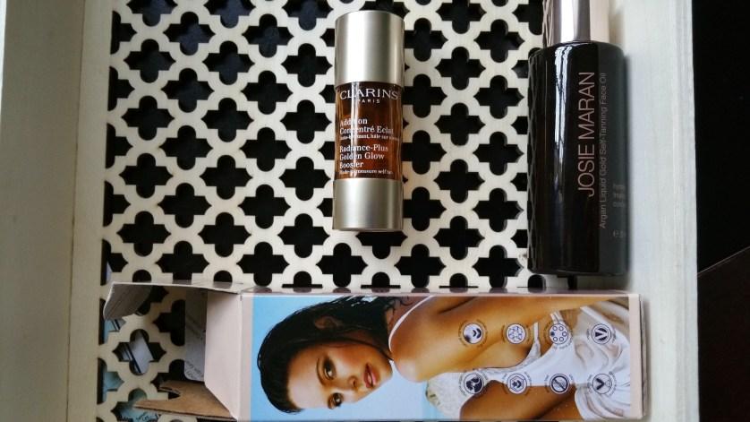 Clarins Radiance-Plus Golden Glow Bronzer and Josie Maran Liquid Gold Self Tanning Facial Oil