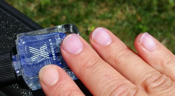 Swatch of Formula X Neon Top Coat Nail Polish and Bare Nail Index Finger