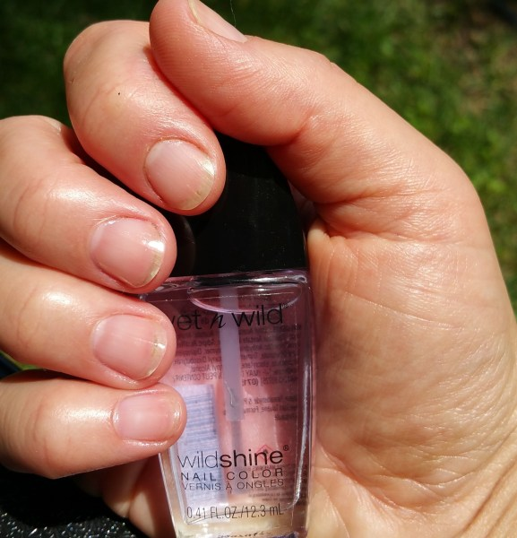 Swatch of Wet N Wild WildShine Nail Polish and Bare Nail Index Finger