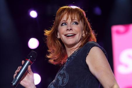 Reba McEntire performs at the CMA Music Festival in Nashville, Tenn., Thursday, June 11, 2009. (AP Photo/Josh Anderson)