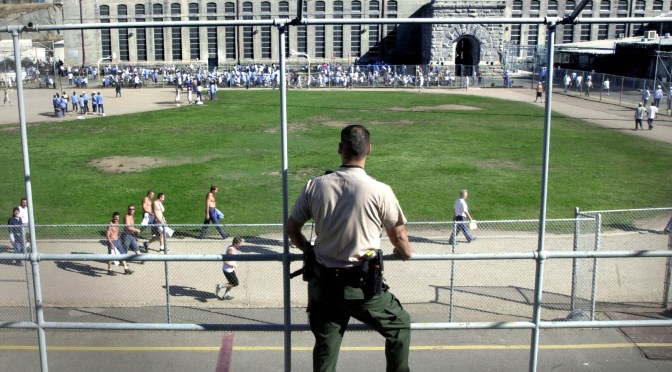"""For the first time in many years, the California Department of Corrections reports that there has been a slight decline in the state's prison population.  At Folsom State Prison (""""Old Folsom"""") October 4, 2001, Correctional Officer Eric Gums watches over the prison's central exercise yard.  The Sacramento Bee / Dick Schmidt (to go with story by John Hill)"""