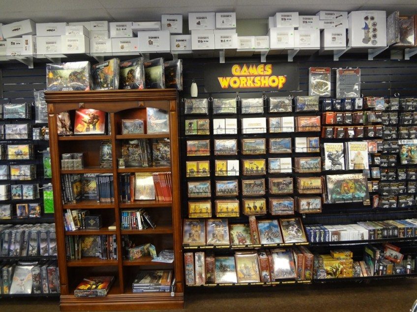 A wall of miniatures and wargames rules in Little Shop of Magic in Las Vegas.
