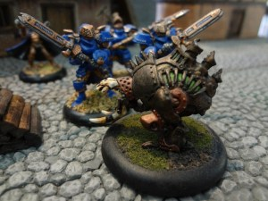 Painted Warmachine figures clash in a fantasy city