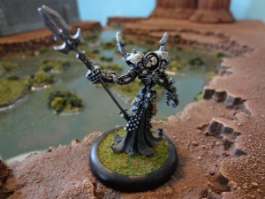Undead miniature Lich poses in front of Terranscapes swamp