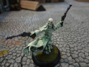 Skull-headed Pistol Wraith miniature on a cobblestone street