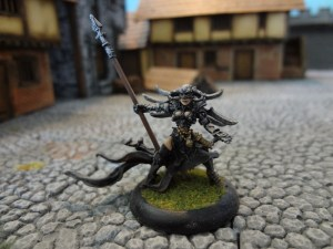 Cryx warwitch Deneghra stands atop Hirst Arts cobblestone streets
