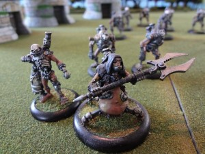 Necromantic Necrotech miniature with Scrap Thrall walking explosion miniatures
