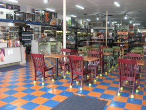 Orange and blue checkerboard floor at Titan's Entertainment Cafe with over 200 board games