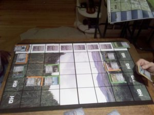 Playing grid on a board game surface with military-themed POWER cards in play