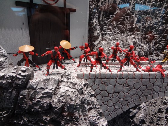 Red Ninja action figures from GI Joe by a building and bridge at the Hasbro Comic-Con 2012 booth