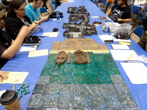 Players get ready to play on Hirst Arts and custom terrain from Legendary Realms at Gen Con gaming table