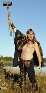 Actor Mark Krupa dressed in fur and leather wielding Mjolnir hammer in the Wild Hunt as Bjorn Magnusson