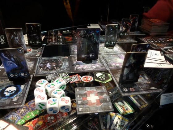 Modular playing tiles for Privateer Press's Level 7 Escape Board Game in a glass display case at Comic-Con 2012