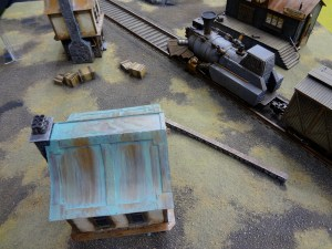 28mm train on tracks on beautiful table layout from Privateer Press at Gen Con