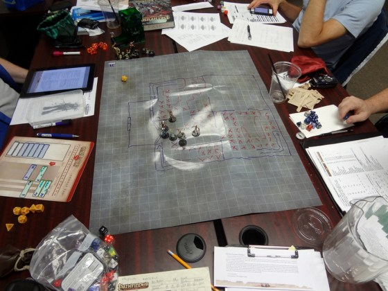 Gaming mat with picture drawn of Absalom granary for Pathfinder adventure Silent Tide with miniatures