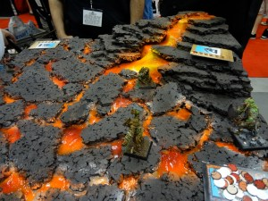 Realistic 28mm scale orange lava flowing over miniature terrain board for Confrontation at 2012 Gen Con