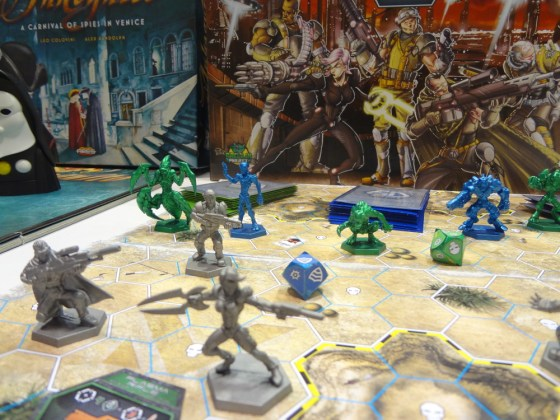 Shiny plastic sci-fi miniatures for board game The Galaxy Defenders on hexagonal playing surface