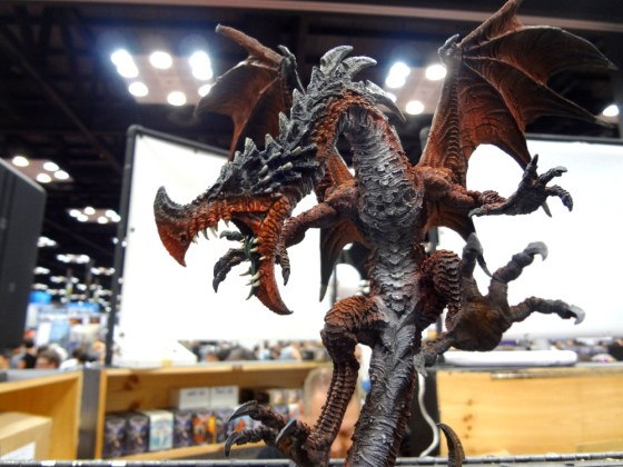 Red, black, grey, and white massive Titan Dragon miniature for Confrontation at Gen Con 2012