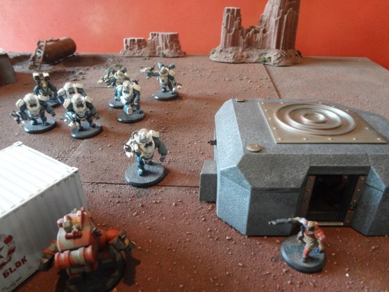 AT-43 miniatures posed next to prepainted grey bunker which has a nub where the wall attaches