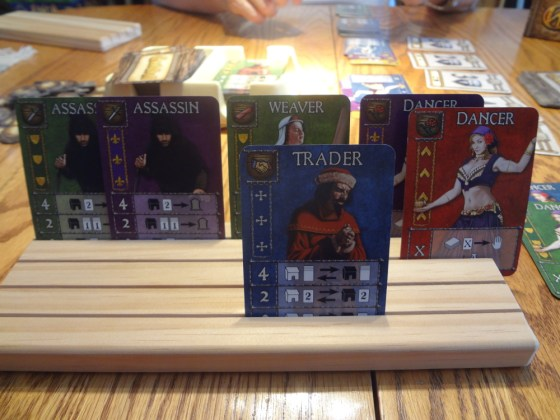 Cards from Guildhall Board Game from AEG held in wooden Card-Boards card holder
