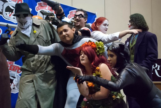 Cosplay Contest at Las Vegas Comic Expo with DC characters Red Son Superman, The Comedian, Poison Ivy blowing a kiss, Catwoman, The Joker, Harley Quinn, and Rorshach