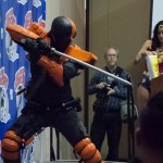 Deathstroke cosplayer brandishes sword on stage at Las Vegas Comic Expo