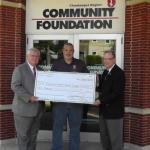 Thomas Wade, Alliance Advisory Group financial representative, presents Michael Carpenter and Randy Sweeney, Chautauqua Region Community Foundation executive director, with a $10,000 check for the Marianne Carpenter Memorial Scholarship.