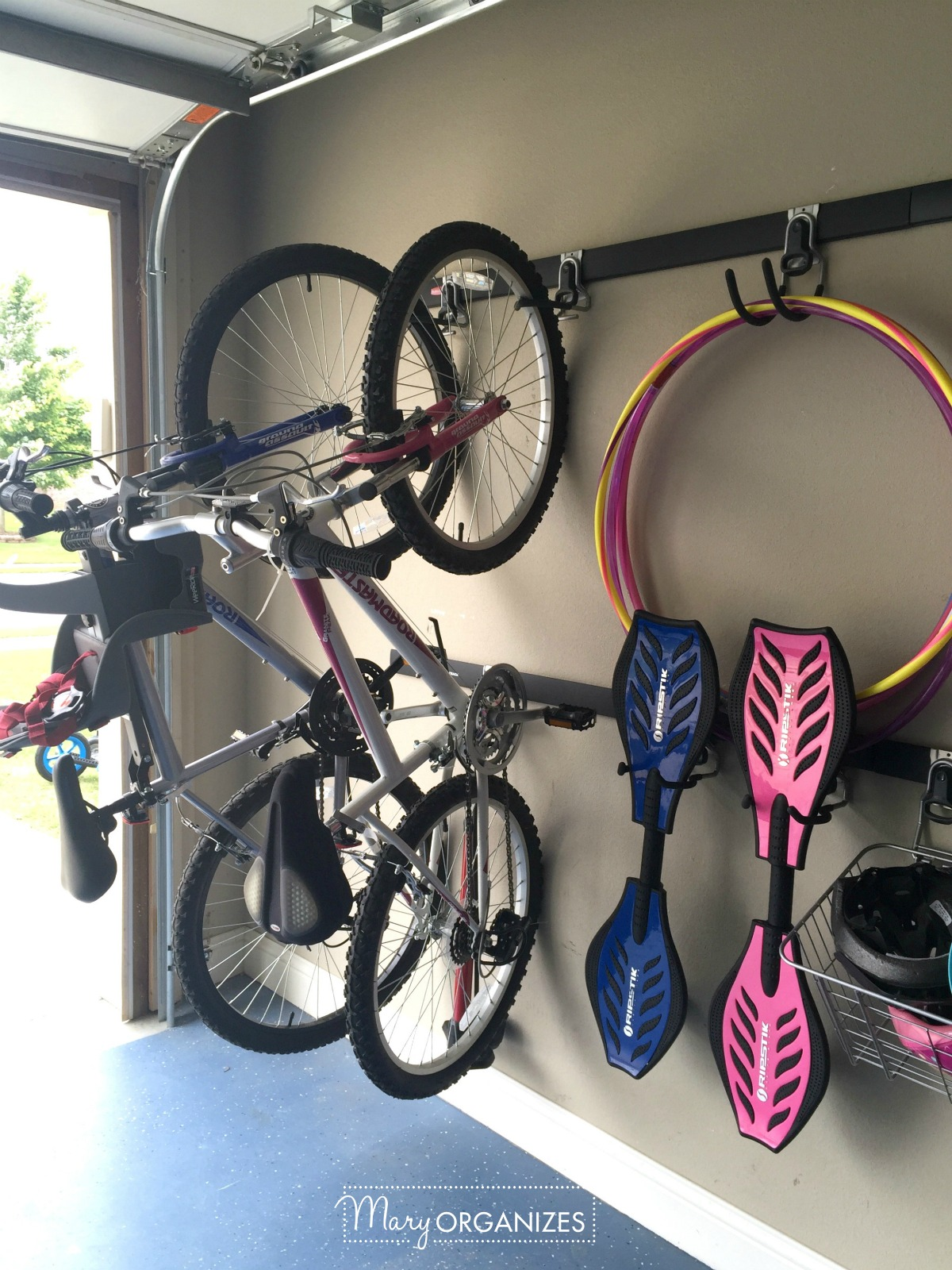 Garage Organizing How To Hang Bikes Scooters Ripsticks Balls More Creatingmaryshome Com
