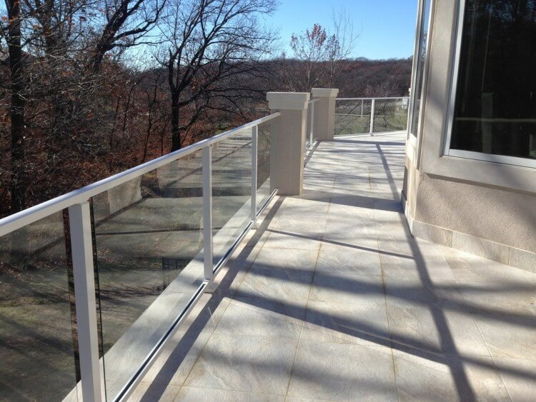 Tile deck, composite sub-floor, stucco columns, glass handrail, built in grill 2