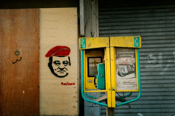 Stencil portrait of Mubarak wearing a military cap by Kaizer