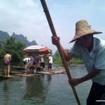 The river is shallow, and our boatman pushes us the whole way.