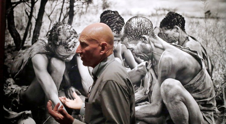 "Brazilian photographer Sebastiao Salgado leads a tour of his exhibition ""Genesis"" on Thursday, April 24, 2014, at the National Museum of Singapore. His latest collection of 245 black-and-white photographs taken around the world, untainted by modern life is part of Salgado's premiere solo showcase in Asia.  (AP Photo/Wong Maye-E)"