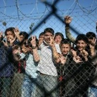 Children peer through the fence of an immigrant detention centre in the village of Filakio, on the Greek-Turkish border. Photograph: Sakis Mitrolidis/AFP/Getty Images