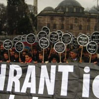 "Protest outside the court, placards proclaim ""For Hrant, For Justice"""