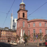 The Paulskirche in Frankfurt stands in the shadow of the banking district