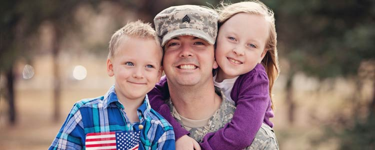 a soldier and his kids smiling
