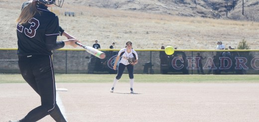 Courtney Letcher (23), sophomore shortstop of Fort Collins, Colorado, swings at a pitch Saturday during the first game against Colorado Christian University. —Photo by Christopher Smith