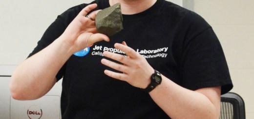 Joslynn VanDerslice, 21, senior of Columbus, displays rocks while speaking Saturday about Mars during Science Days. —Photo by Teri Robinson