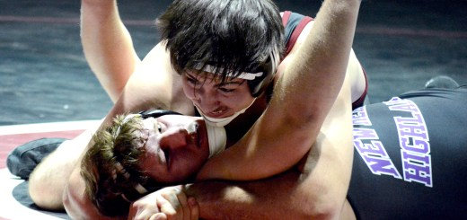 Cooper Cogdill, redshirt freshman of Chadron, 285-pounds, pins New Mexico Highlands University's Corbin Grenowich, freshman of San Diego, California, Thursday in a dual at the NPAC. —Photo by Jordyn Hulinsky