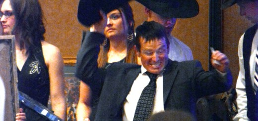 Rodeo Coach Dustin Loper throws his hat into the hair indicating his bid Saturday at the Black Tie Calf Fry event in the Student Center Ballroom.