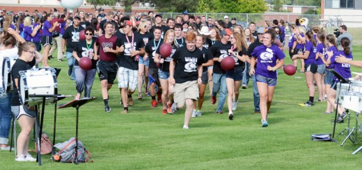 Incoming students rush through a tunnel of Eagle Leaders onto Elliott Field Thursday, Aug. 18, during a pep rally. —Photo by Jordyn Hulinsky