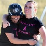 Kendyl Moody, sophomore shortstop of Lakewood, Colorado, hugs alum Katelyn Kruger Saturday during the alumni game at the softball field.—Photo by Jordyn Hulinsky