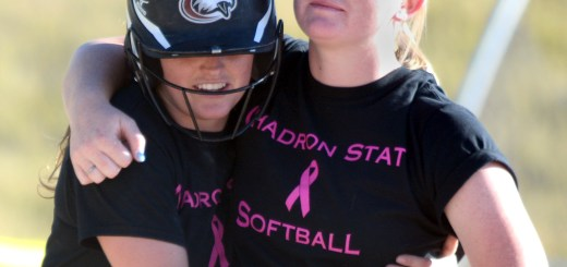 Kendyl Moody, sophomore shortstop of Lakewood, Colorado, hugs alum Katelyn Kruger Saturday during the alumni game at the softball field.—Photo by Jordyn Hulinsky