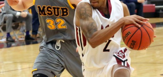Warren Gordon (2), senior of Indianapolis, drives the ball Saturday against Sven Jeushcede (32), sophomore of Roesrath, Germany, of Montana State University Billings, Nov. 22, in the Chicoine Center. The Eagles lost 89-69.—File Photo by Justine Stone