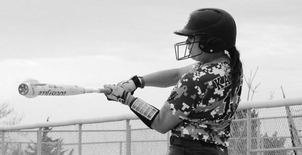 Lindsey Karlin (11), senior of Berthoud, Colorado, hits a single Tuesday against University of Nebraska atKearney at the CSC softball field. —Photo by Angie Webb
