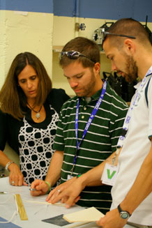 From left to right, Academy School District 20 teachers Kirsten Burda, Robert Young and Kevin McGregor work on designing and assembling their glider project. Photo by Julie Imada