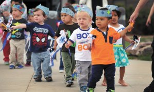 U.S. Air Force photo/Dennis Rogers Kids with the Child Development Center participate in the pinwheel parade April 30, 2015, at Schriever Air Force Base, Colo. April marked Sexual Assault Awareness and Prevention month, Child Abuse Awareness month and Month of the Military Child. Each color of the pinwheel represents one of the themes. Blue represents Child Abuse Awareness Month, teal represents SAAPM and purple represents Month of the Military Child.