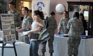 U.S. Air Force photo/Brian Hagberg Team 5-0 members gather information about various Colorado Springs organizations during the Airman and Family Readiness Center's Volunteer Info Fair in the atrium of Building 210 Thursday at Schriever Air Force Base, Colo. A dozen agencies were on hand to provide information and volunteer opportunities for members.