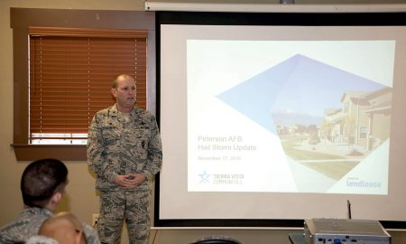 (U.S. Air Force photo by Steve Kotecki) PETERSON AIR FORCE BASE, Colo. - Col. Doug Schiess, 21st Space Wing commander, speaks to housing residents during a town hall meeting at Peterson Air Force Base, Colo., Nov. 18, 2016. The town hall informed residents of Tierra Vista Community about the repair plans for homes damaged during the hail storm that occurred here on July 28.